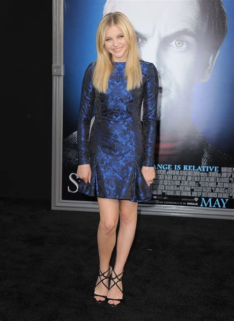 Chloe Moretz wore black strappy heels with a shiny royal